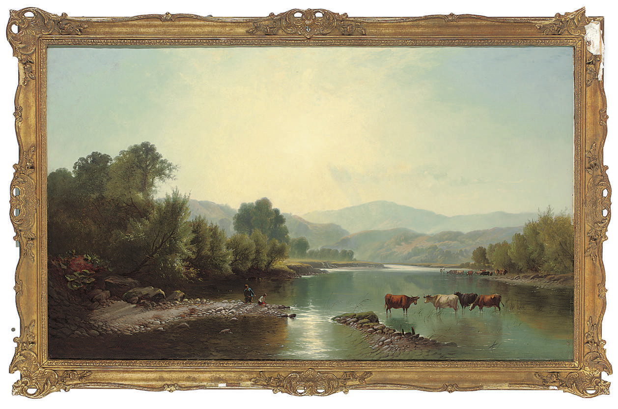 Cattle watering in a summer landscape