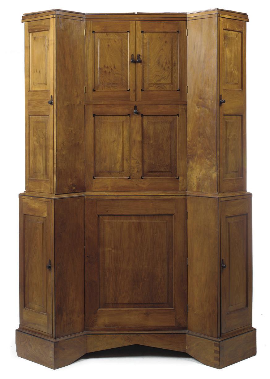 AN EDWARD BARNSLEY WALNUT CORNER CABINET