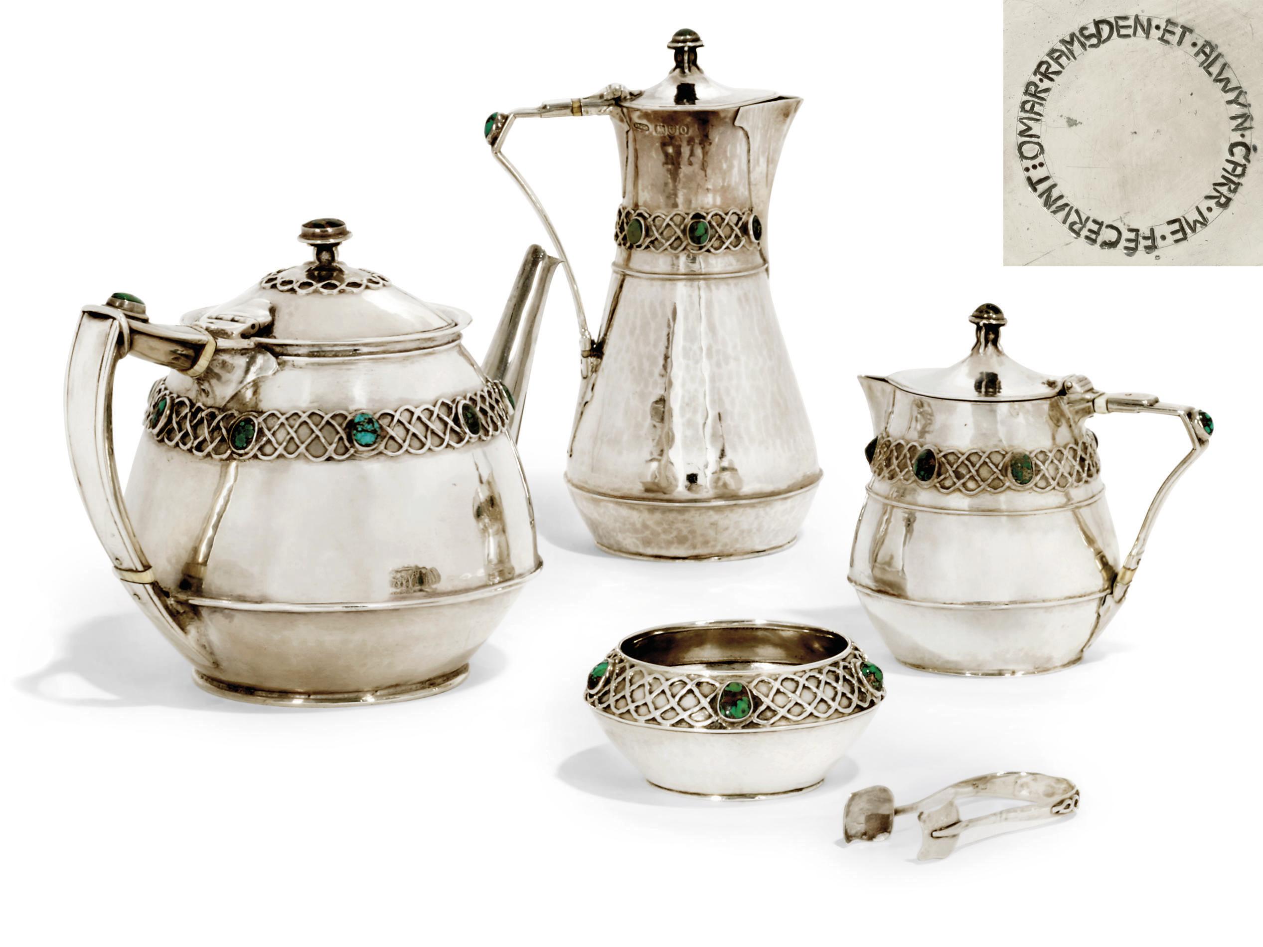 AN EDWARDIAN ARTS & CRAFTS FOUR-PIECE SILVER TEA SET