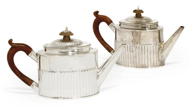A PAIR OF GEORGE III SILVER TEAPOTS