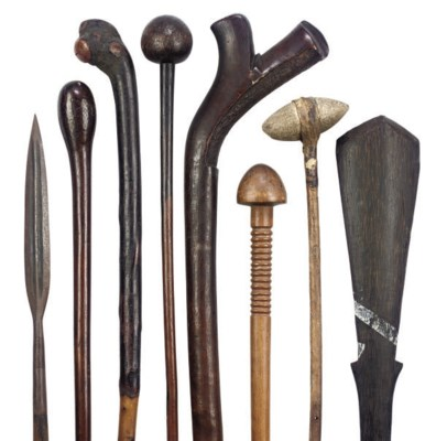 a collection of african and other tribal clubs and weapons