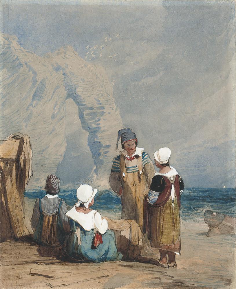 Figures by the coast at Durdle Door, Dorset