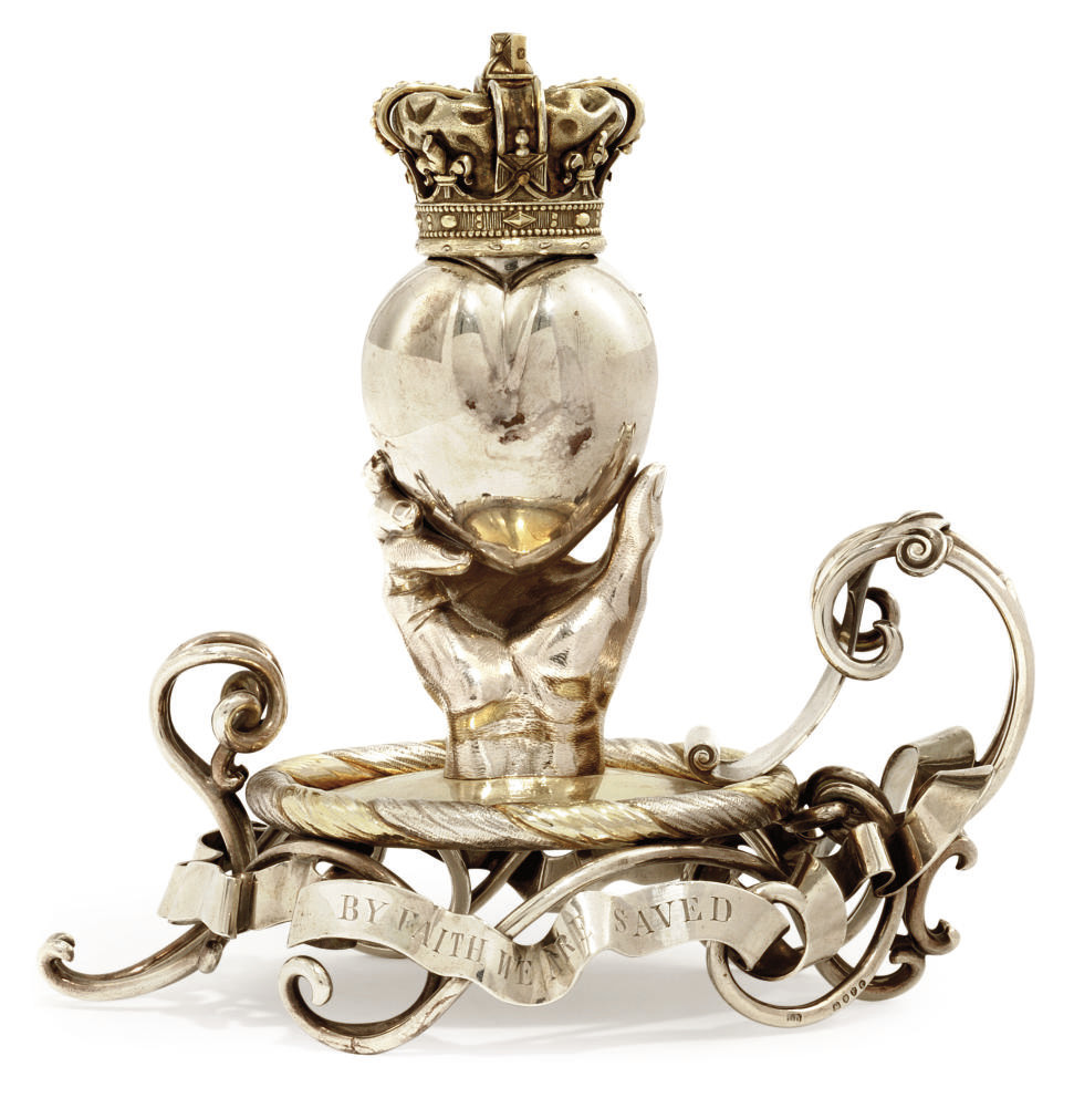 A VICTORIAN PARCEL-GILT SILVER NOVELTY CHAMBERSTICK OF HERALDIC FORM