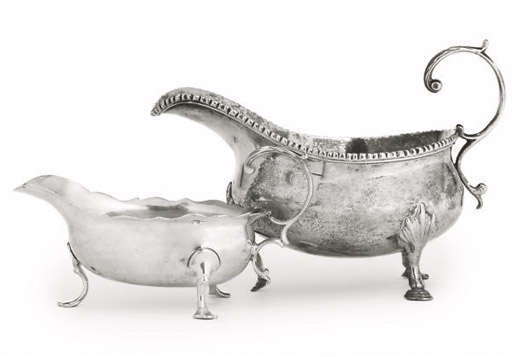 A GEORGE III SILVER SAUCE BOAT
