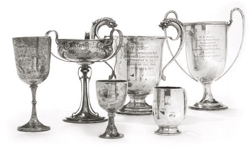 A SILVER THREE-HANDLED ARTS AND CRAFTS TROPHY CUP