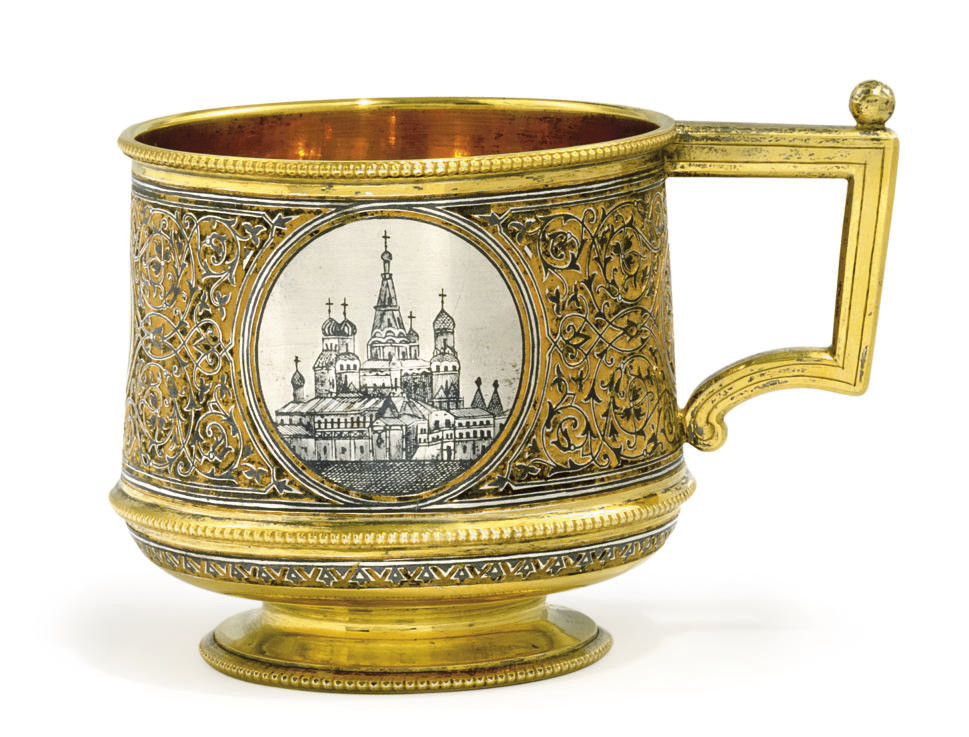 A RUSSIAN SILVER PARCEL-GILT AND NIELLO LEMON-TEA GLASS HOLDER