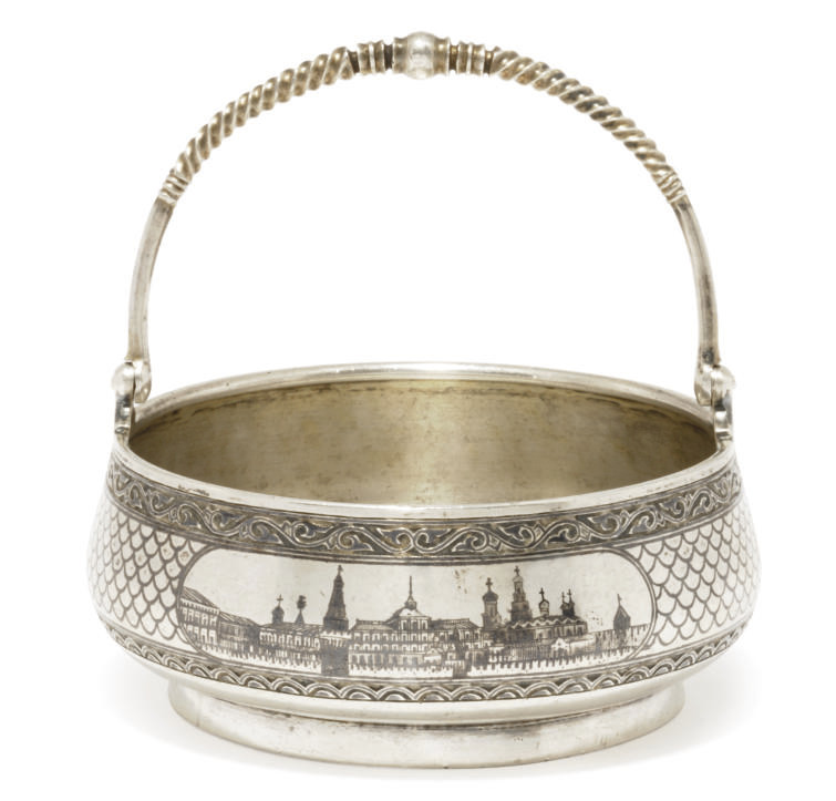 A RUSSIAN PARCEL-GILT SILVER AND NIELLO SWING-HANDLED SUGAR BASKET
