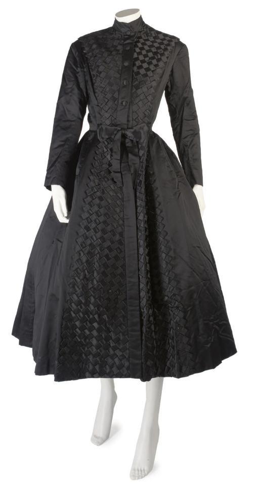 BALMAIN COUTURE, A FINE BLACK SILK COAT DRESS, CIRCA 1952