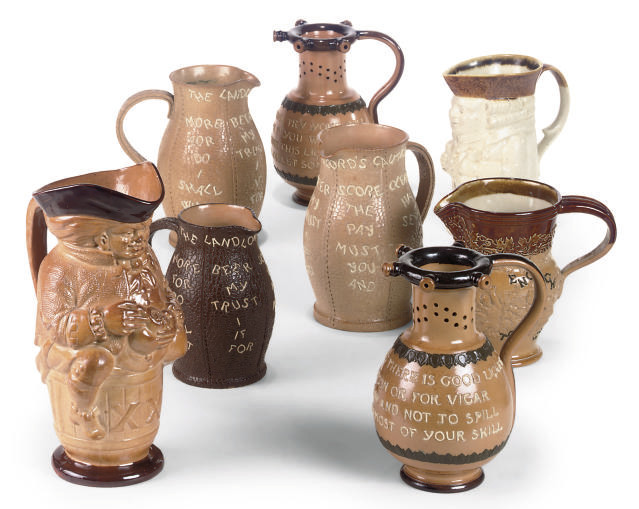 EIGHT ROYAL DOULTON BROWN STONEWARE JUGS