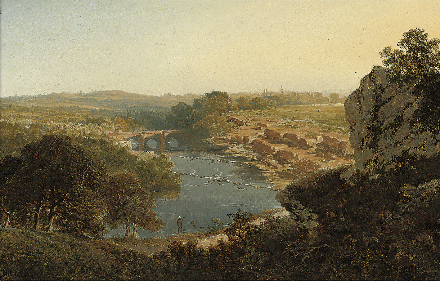 An angler in an extensive river landscape