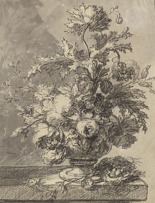 A bouquet of flowers in a terracotta vase