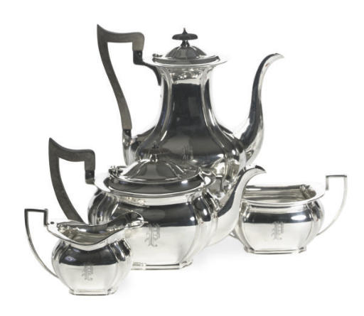 A GEORGE V SILVER FOUR-PIECE TEA AND COFFEE SERVICE AND A GEORGE II COFFEE POT,