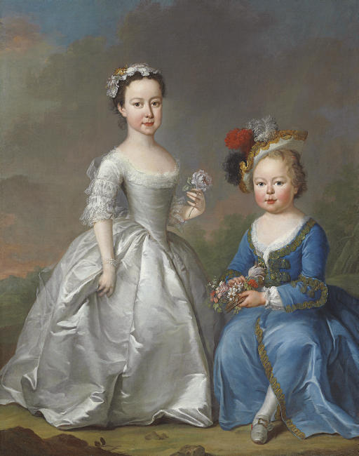 Double portrait of two children in a landscape