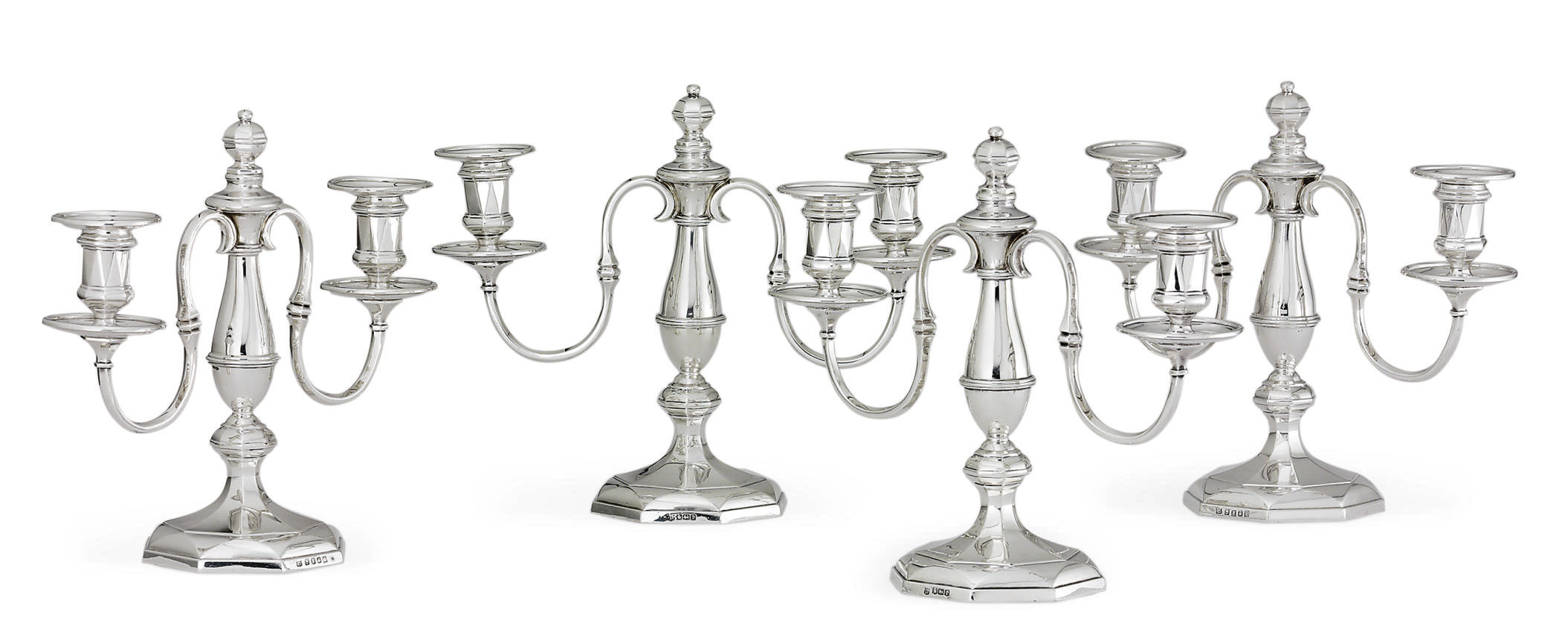 A SET OF FOUR GEORGE V SILVER TWO-LIGHT CANDELABRA