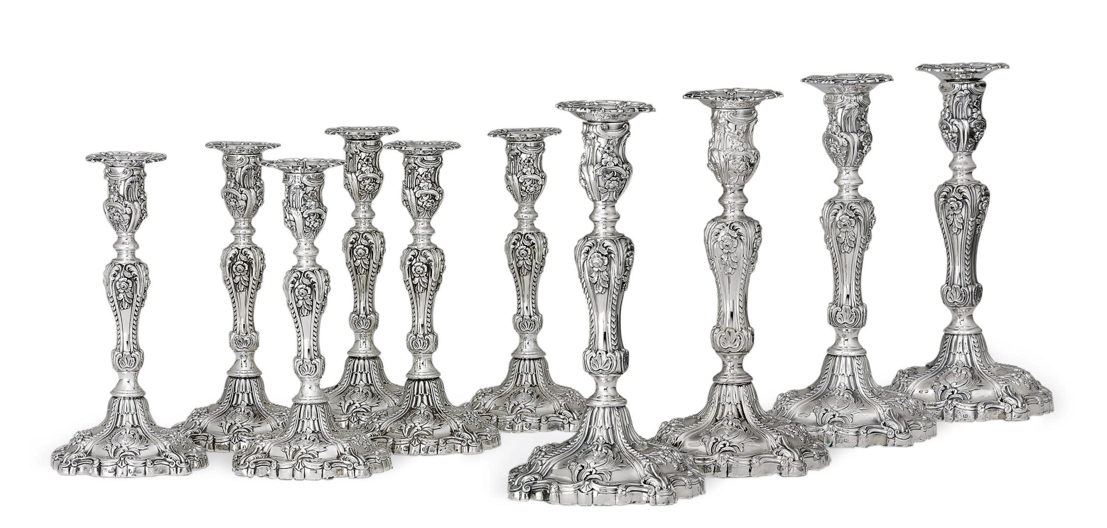 A SET OF TEN WILLIAM IV AND VICTORIAN SILVER CANDLESTICKS