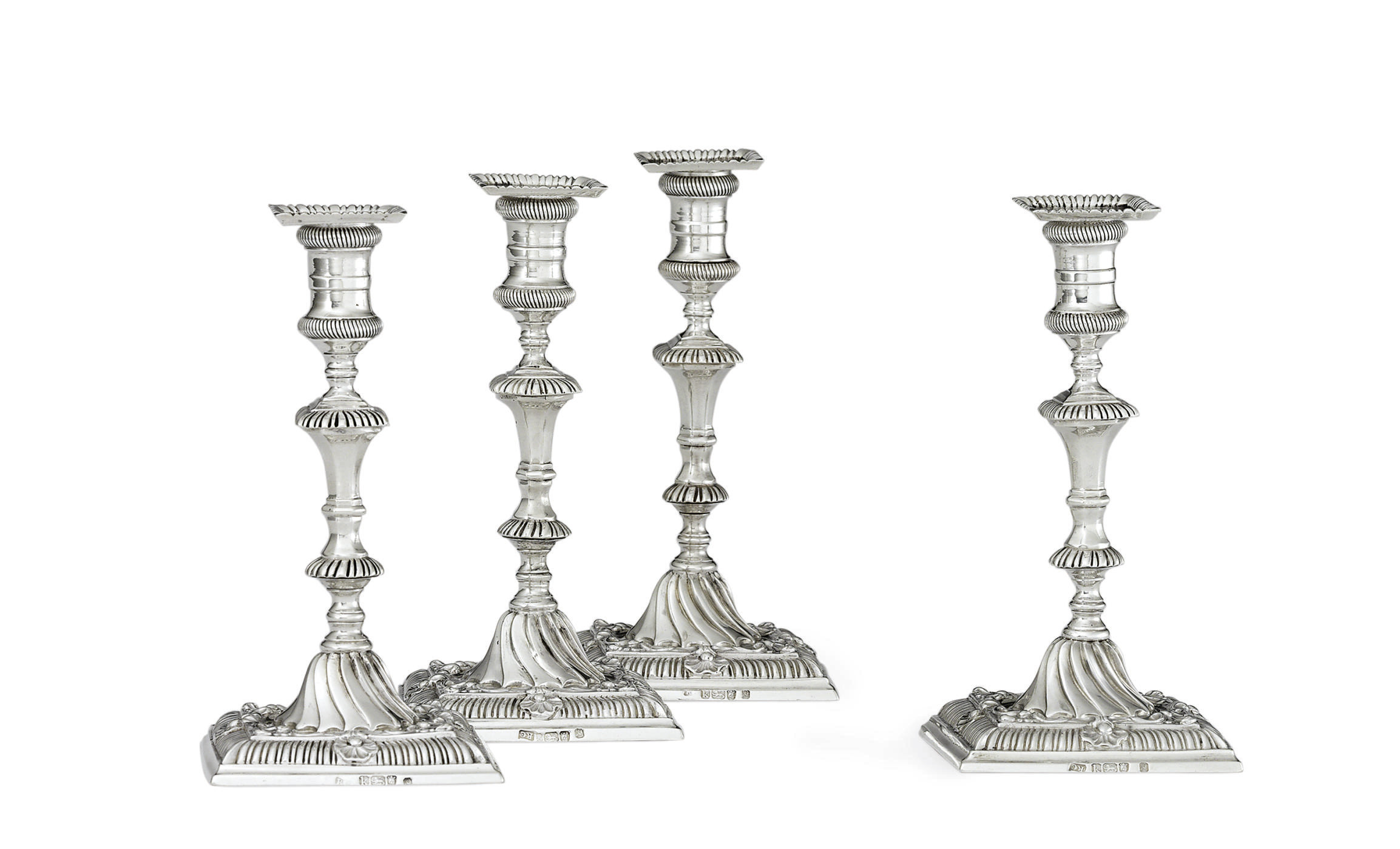 A RARE SET OF FOUR GEORGE III SILVER TAPERSTICKS