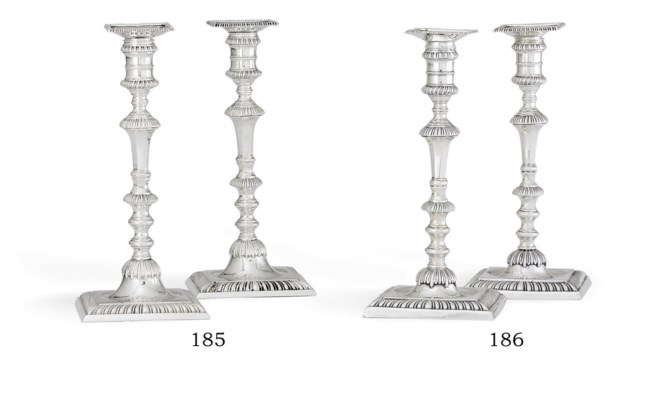 A PAIR OF GEORGE III SILVER CANDLESTICKS , MARK OF WILLIAM