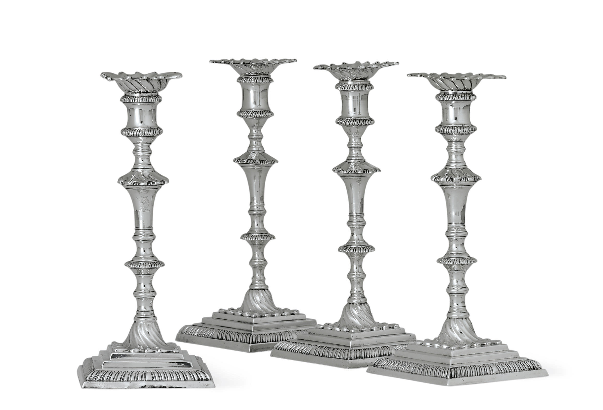 FOUR GEORGE III SILVER CANDLESTICKS