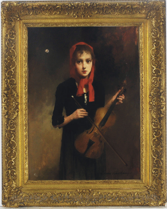 A young girl holding a violin