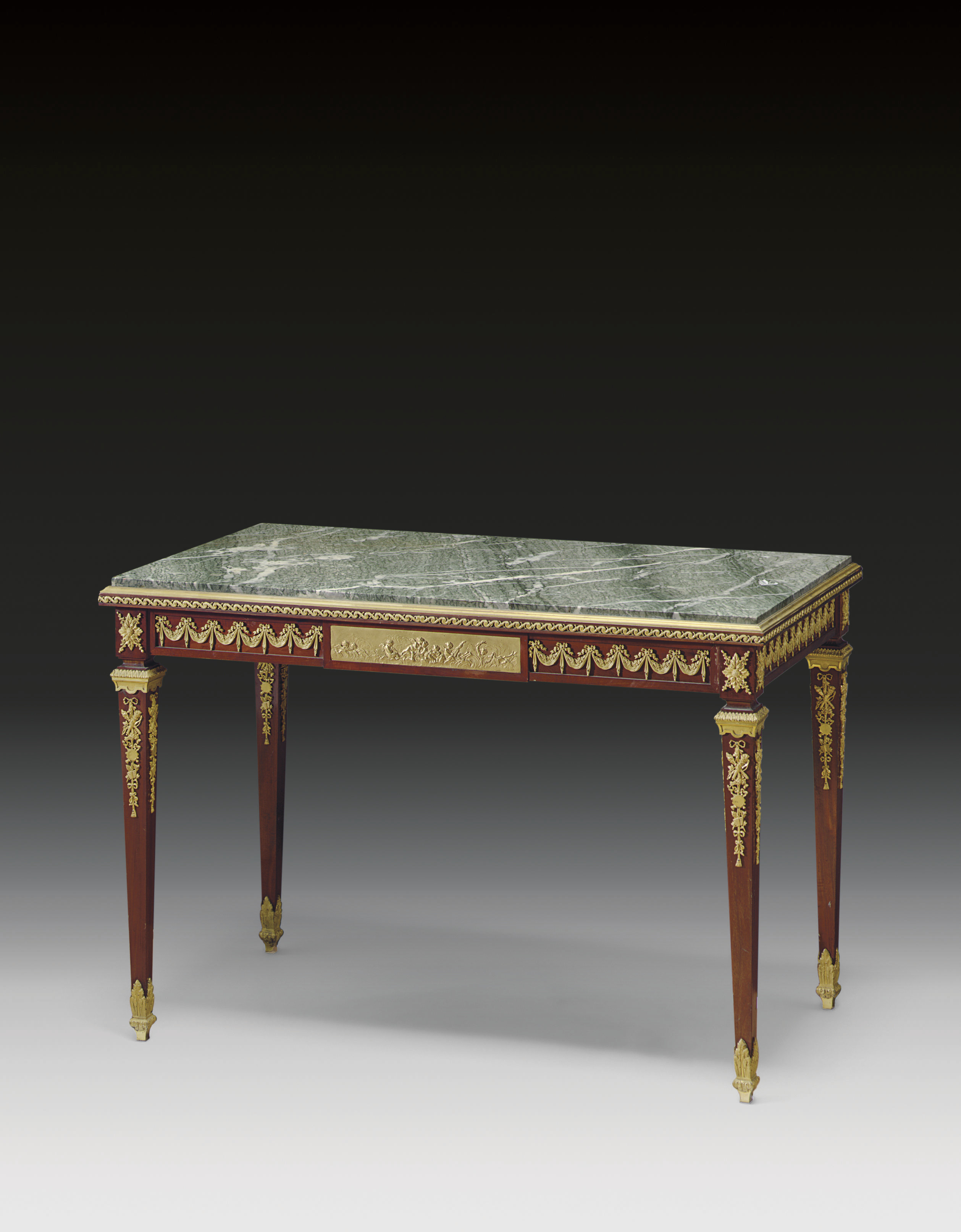 A FRENCH ORMOLU-MOUNTED MAHOGANY CENTRE-TABLE