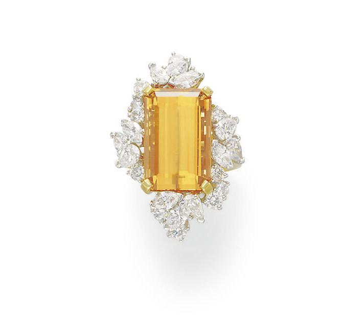 A TOPAZ AND DIAMOND RING, BY KURT WAYNE