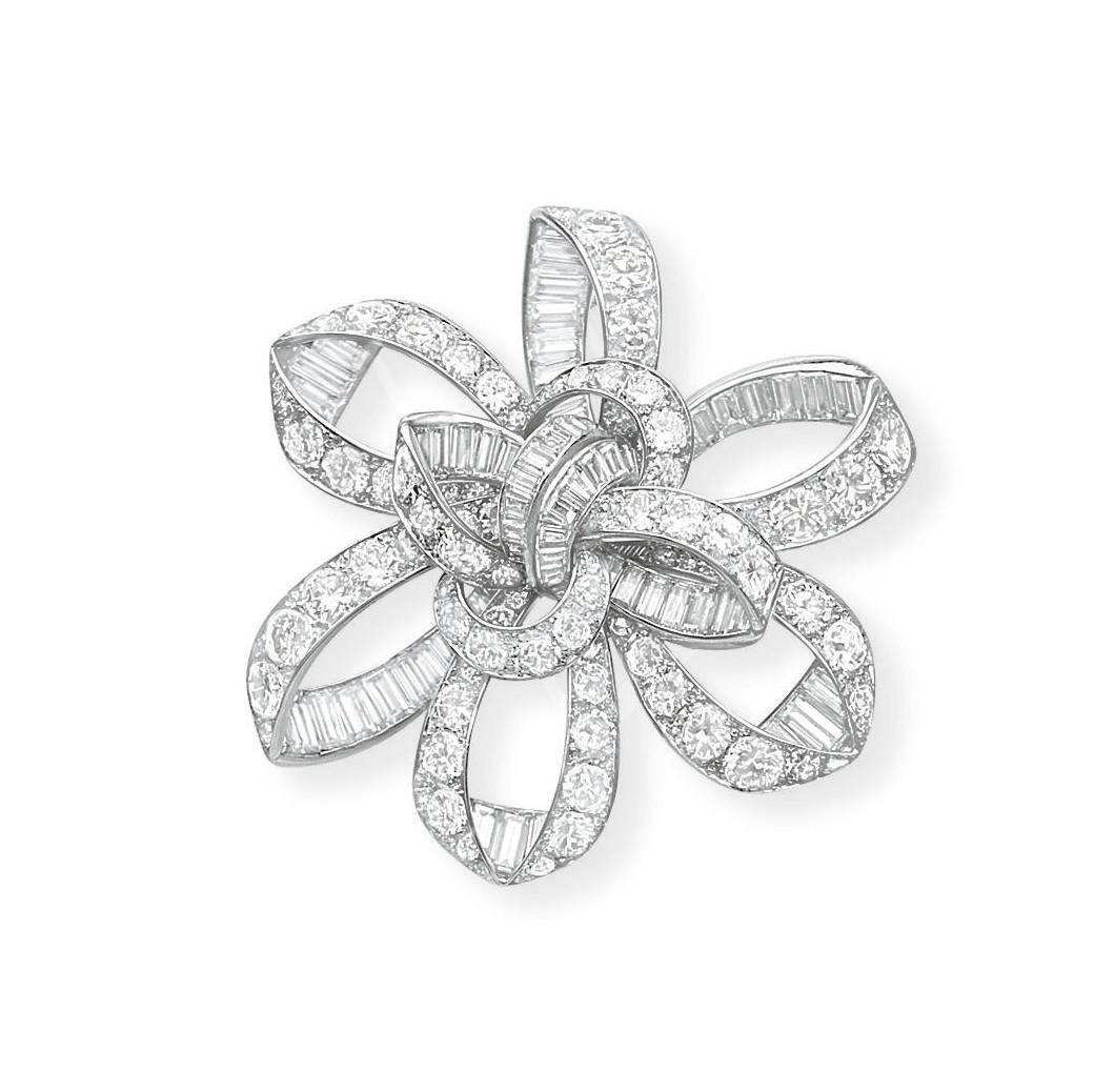 A STYLISH DIAMOND BROOCH, BY JOHN RUBEL