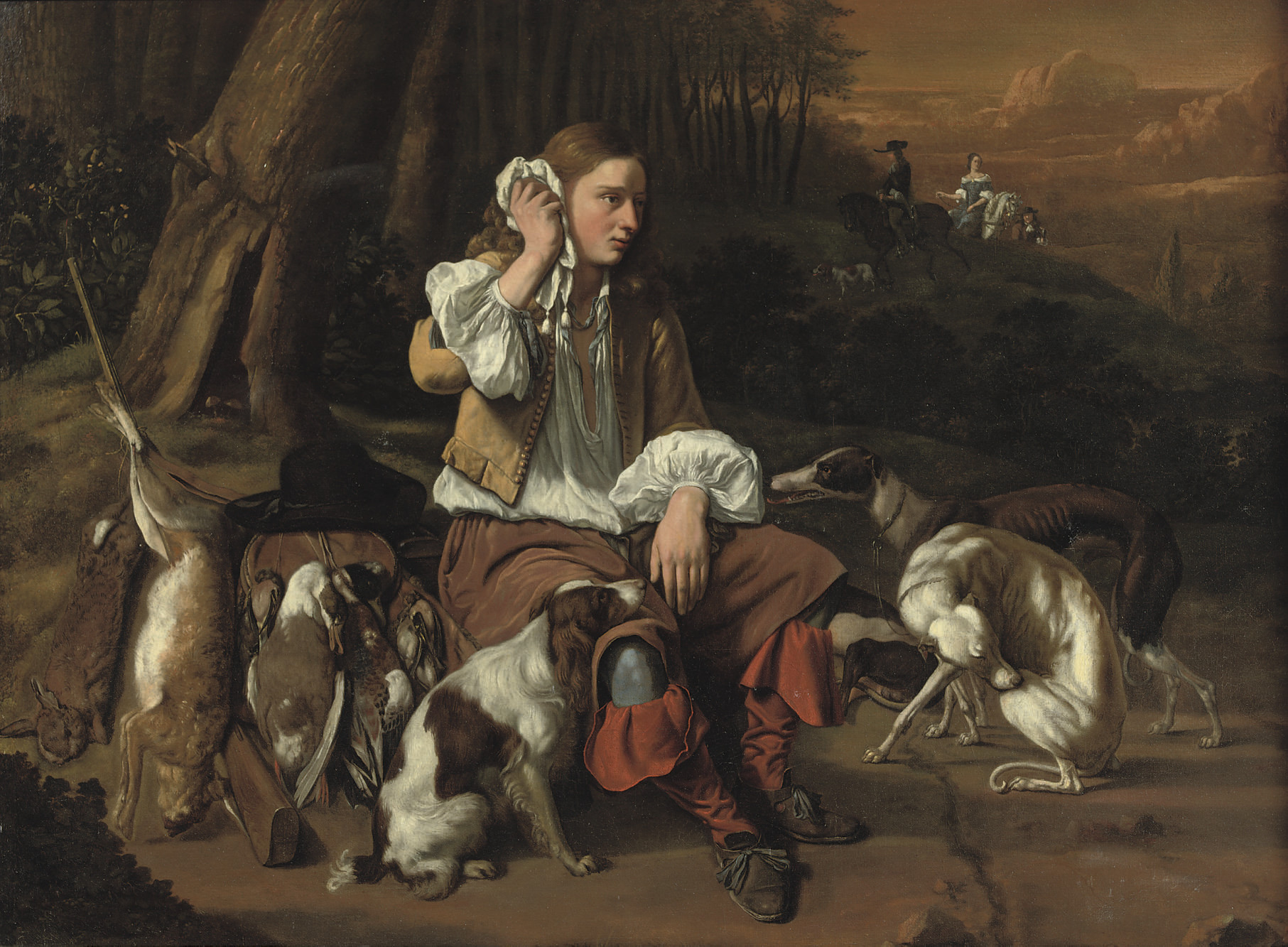 A young hunter at rest in a landscape