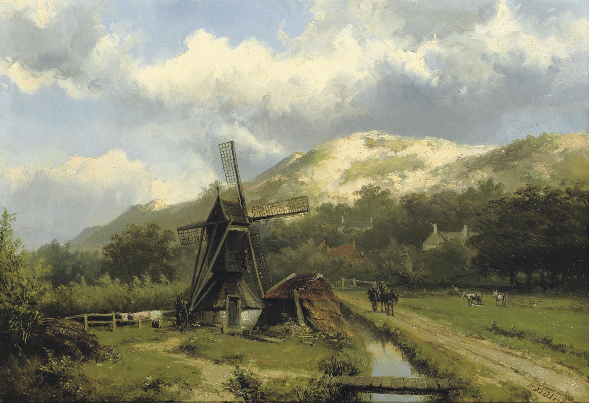 A windmill in a dune landscape