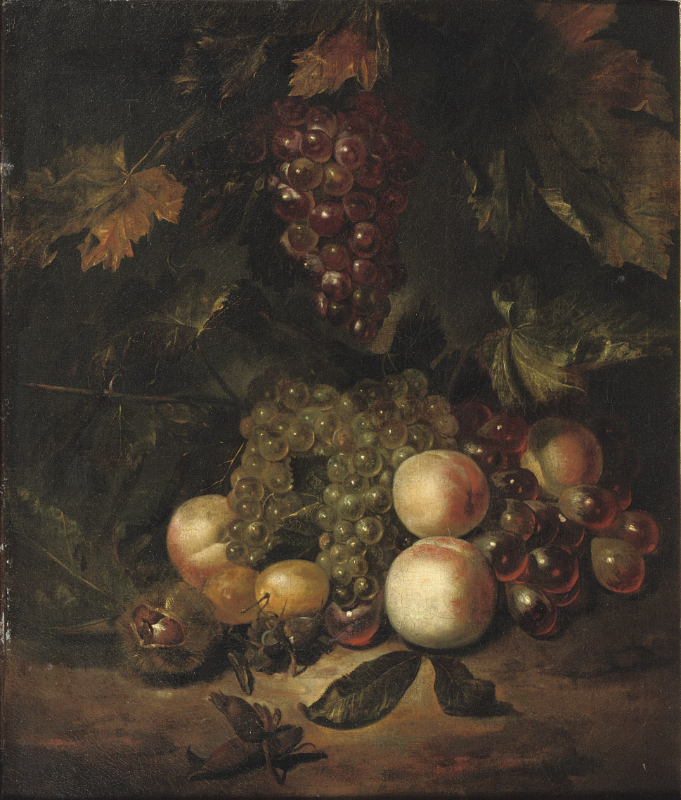 Black and white grapes, peaches, plums, chest- and hazelnuts on a forest floor