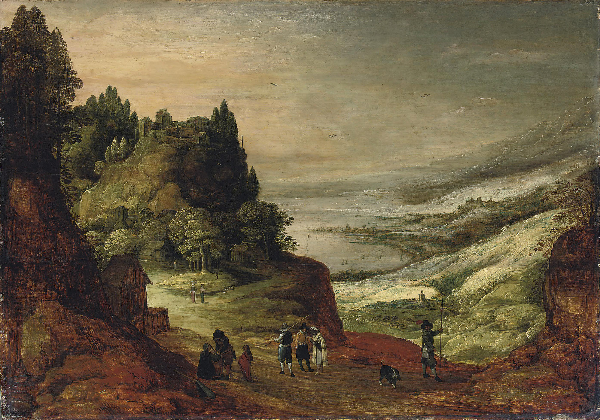 An extensive mountainous river landscape with figures conversing on a track, a village beyond