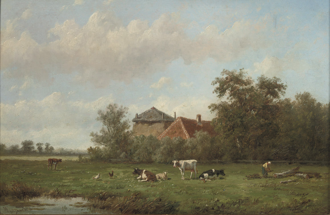 Cattle grazing with a farmstead beyond