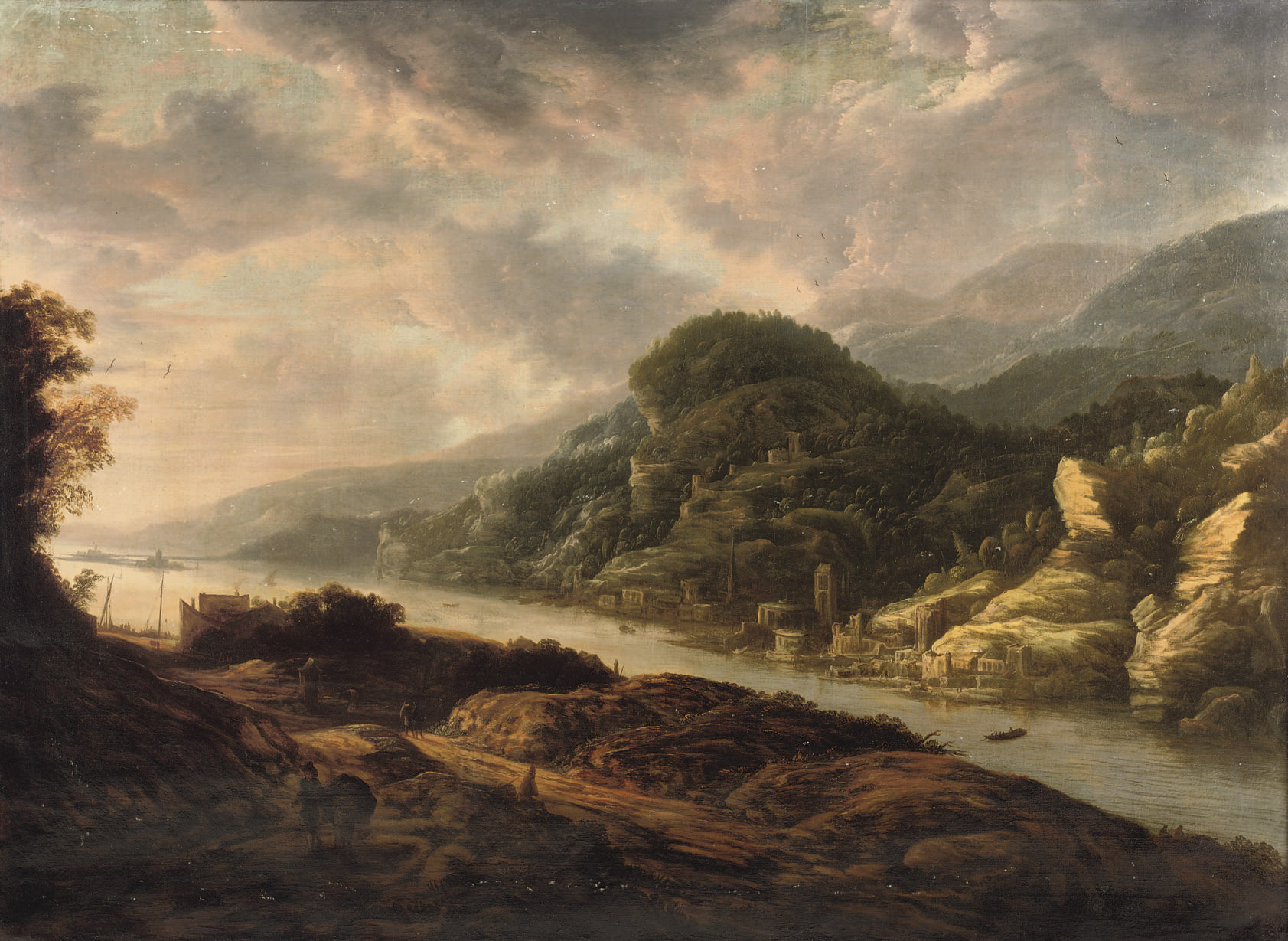 A river landscape with travellers on a path and a town along the river