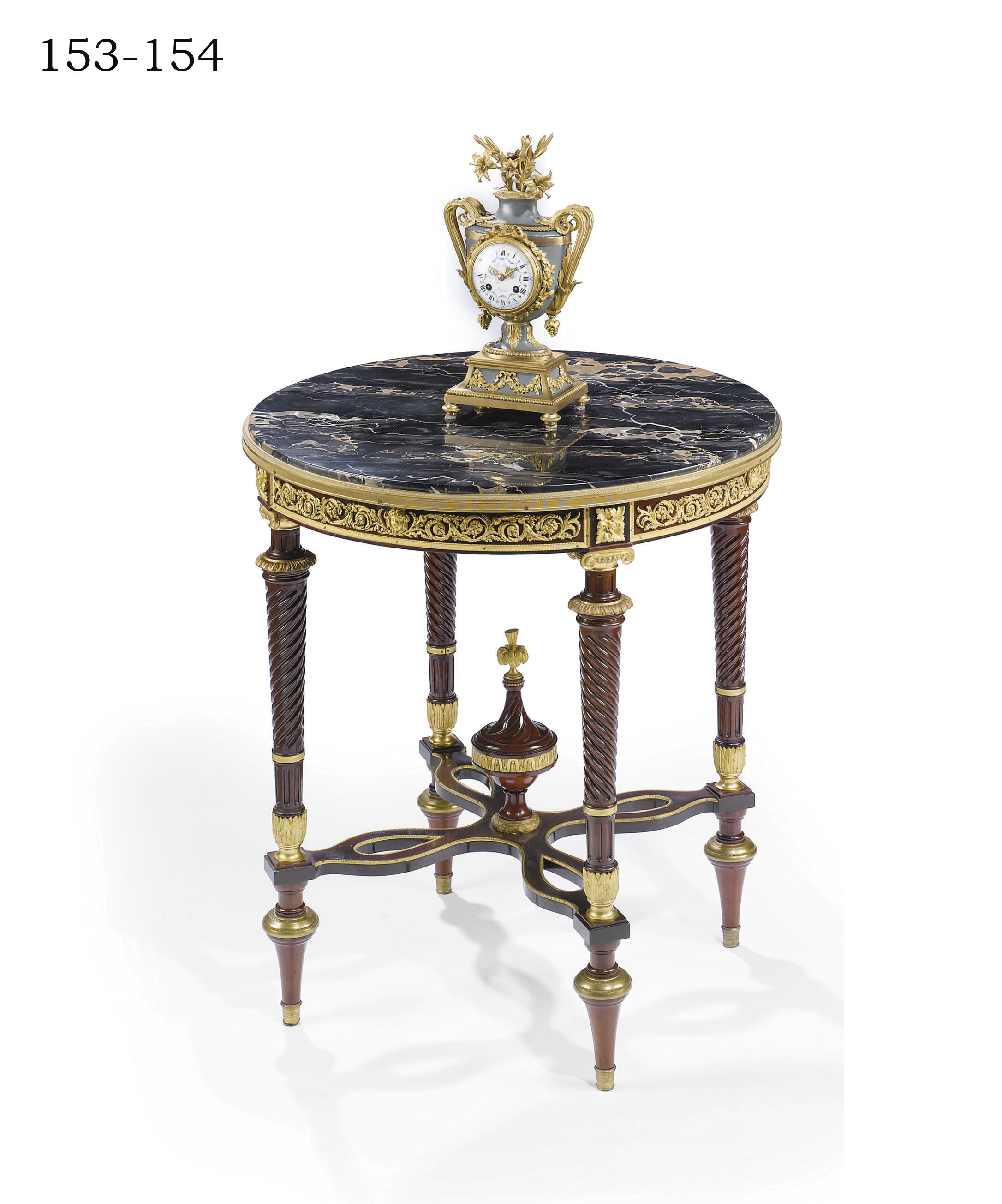 A FRENCH ORMOLU AND GREEN PATINATED MANTEL CLOCK
