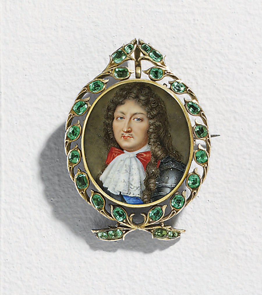 King Louis XIV of France (1638-1715), in plate armour with fine white Venetian lace cravat, red bow, wearing the blue moiré sash of the Royal French Order of Holy Ghost, long natural curling brown wig with knotted locks