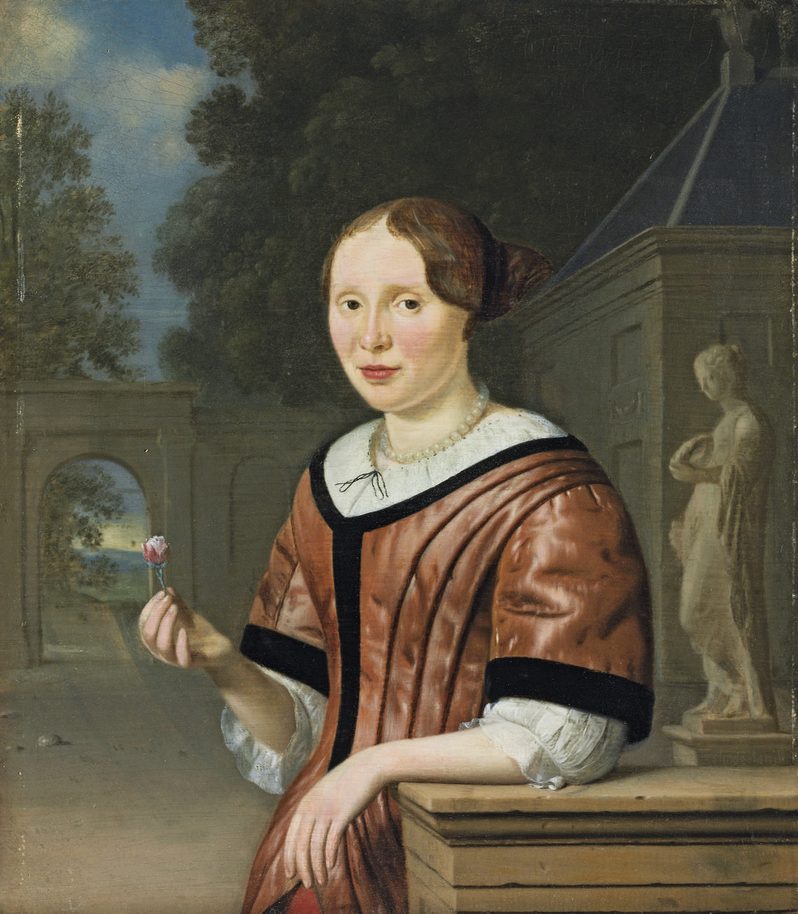 Portrait of a lady, half-length, in pink with pearls, holding a pink rose, beside a statue of Flora, in a courtyard, a landscape beyond