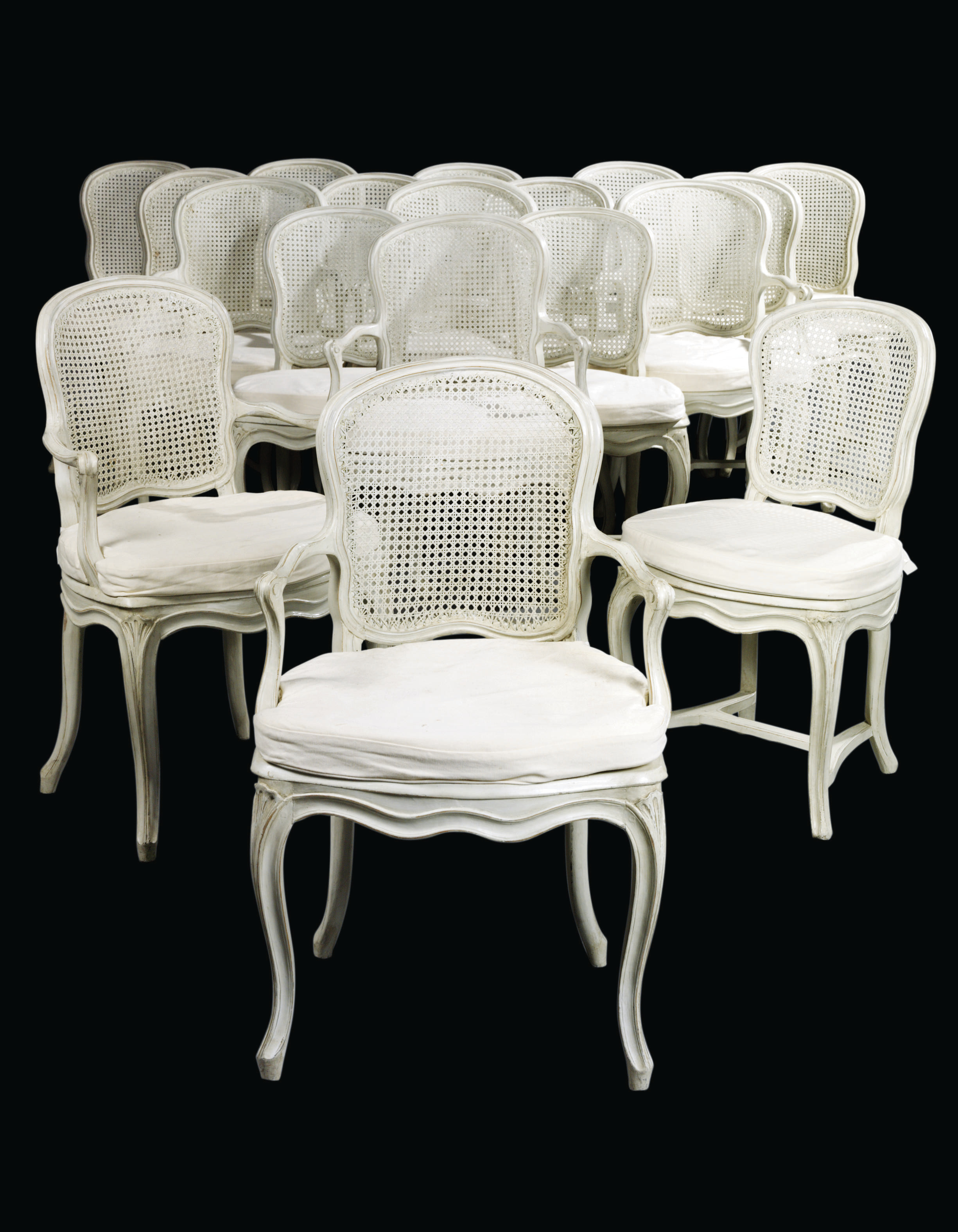 A MATCHED SET OF EIGHTEEN LOUIS XV WHITE-PAINTED CANED DINING-CHAIRS