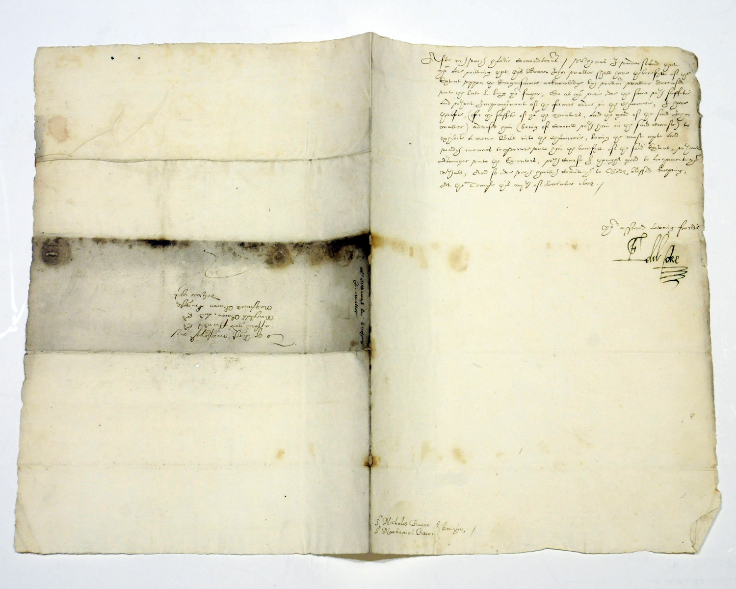 COKE, Sir Edward (1552-1634). Letter signed ('Edw. Coke') to Sir Nathaniel and Sir Nicholas Bacon, 'At the Temple', 4 December 1604, informing them of the right of John Waller to 'the benefytt of your Extent upon the Recognisaunce acknowledge [sic] by William Waller deceased unto the late L[ord] Keep[er] your father'; he has advised Waller to 'exhibit a newe Bill into the chauncerie' as the best means of procuring this, half page, folio, address leaf, small impressed seal. Provenance: Sotheby's sale, 22 June 1976, lot 71.