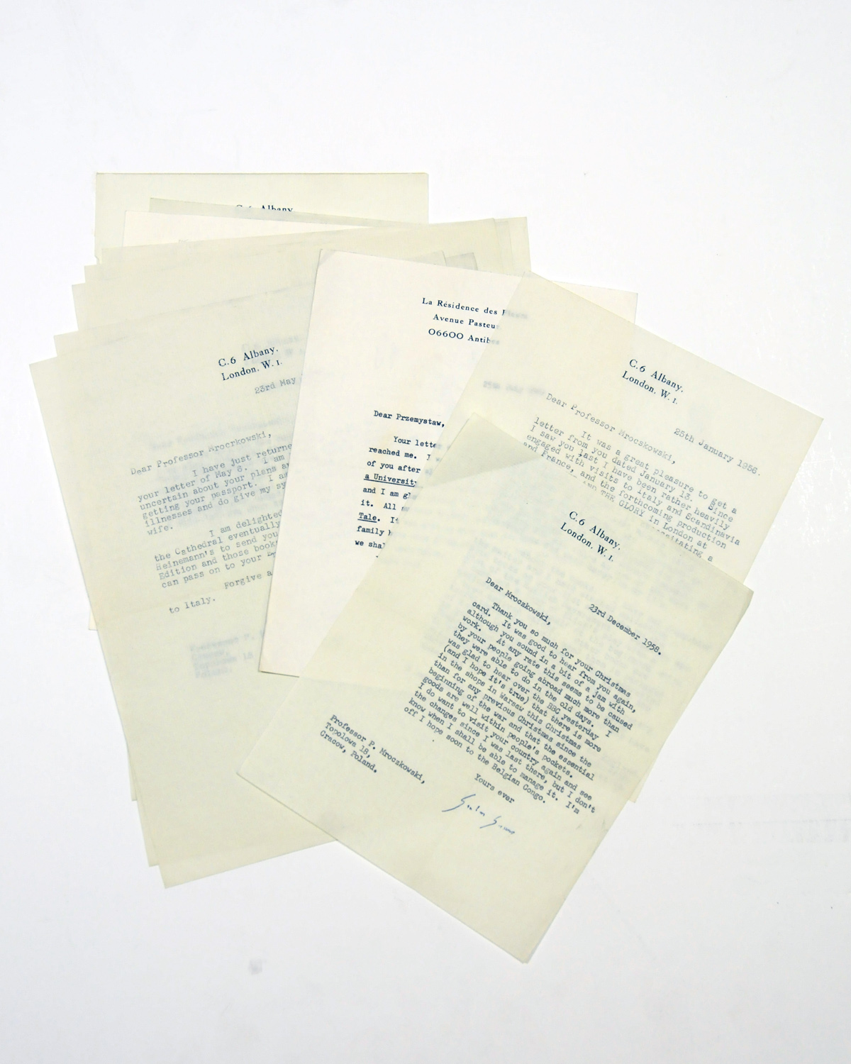 GREENE, Graham (1904-1991). A series of 11 typed letters signed ('Graham Greene', 'Graham') to Professor Przemyslaw Mroczkowski, C6 Albany, London and La Résidence des Fleurs, Antibes, 25 January 1956 - 25 July 1988 (all but two before 1960), referring to their meeting in Cracow, his gifts of books (including an inscribed copy of Murder in the Cathedral), the preparations for a stage production of The Power and the Glory, and a trip to the Belgian Congo, 'I am about half way through a novel set in a leproserie of the Belgian Congo [A Burnt Out Case]', together 11 pages, 4to, with a secretarial letter, and an inscribed copy ('For Professor Mroczkowksi with happy memories of our first meeting in Cracow, Nov. 18, 1955') of The Power and the Glory (Heinemann Pocket Edition, 1945). Provenance: by descent from the recipient. 	 (12)