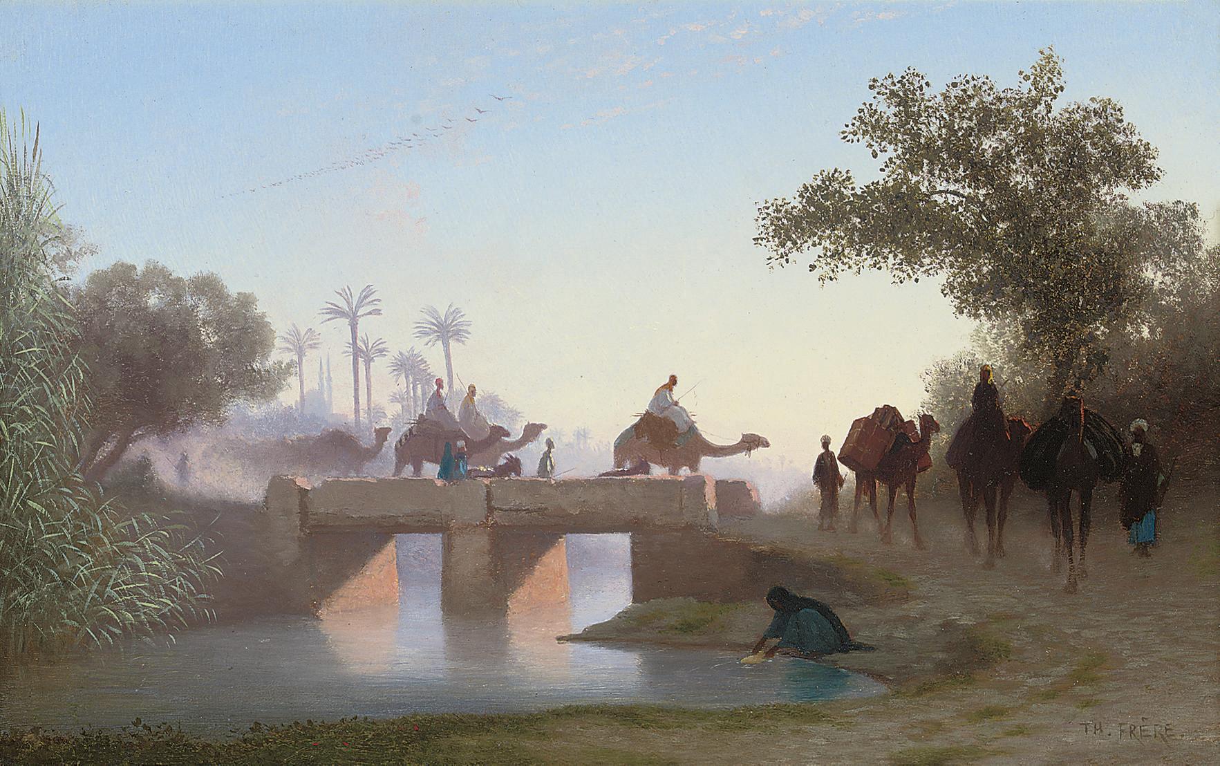 A camel train crossing a river