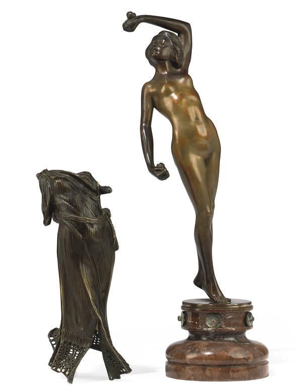 AN AUSTRIAN BRONZE MODEL OF A DANCING LADY