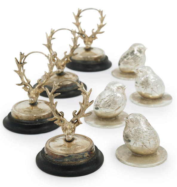 A SET OF FOUR NOVELTY EDWARDIAN SILVER MENU HOLDERS