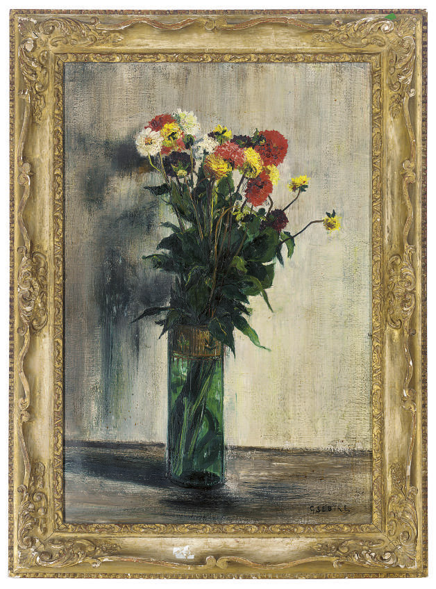 Chrysanthemums in a glass vase on a ledge