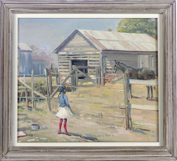 Girl standing at the paddock