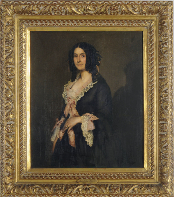 Portrait of a lady in a black dress with pink ribbons