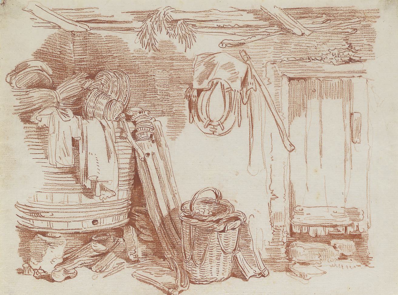 The interior of a shed with a large barrel, baskets and farm equipment