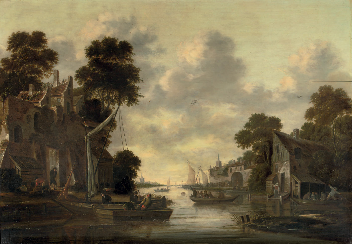 A river landscape with fishermen and their boats by a village