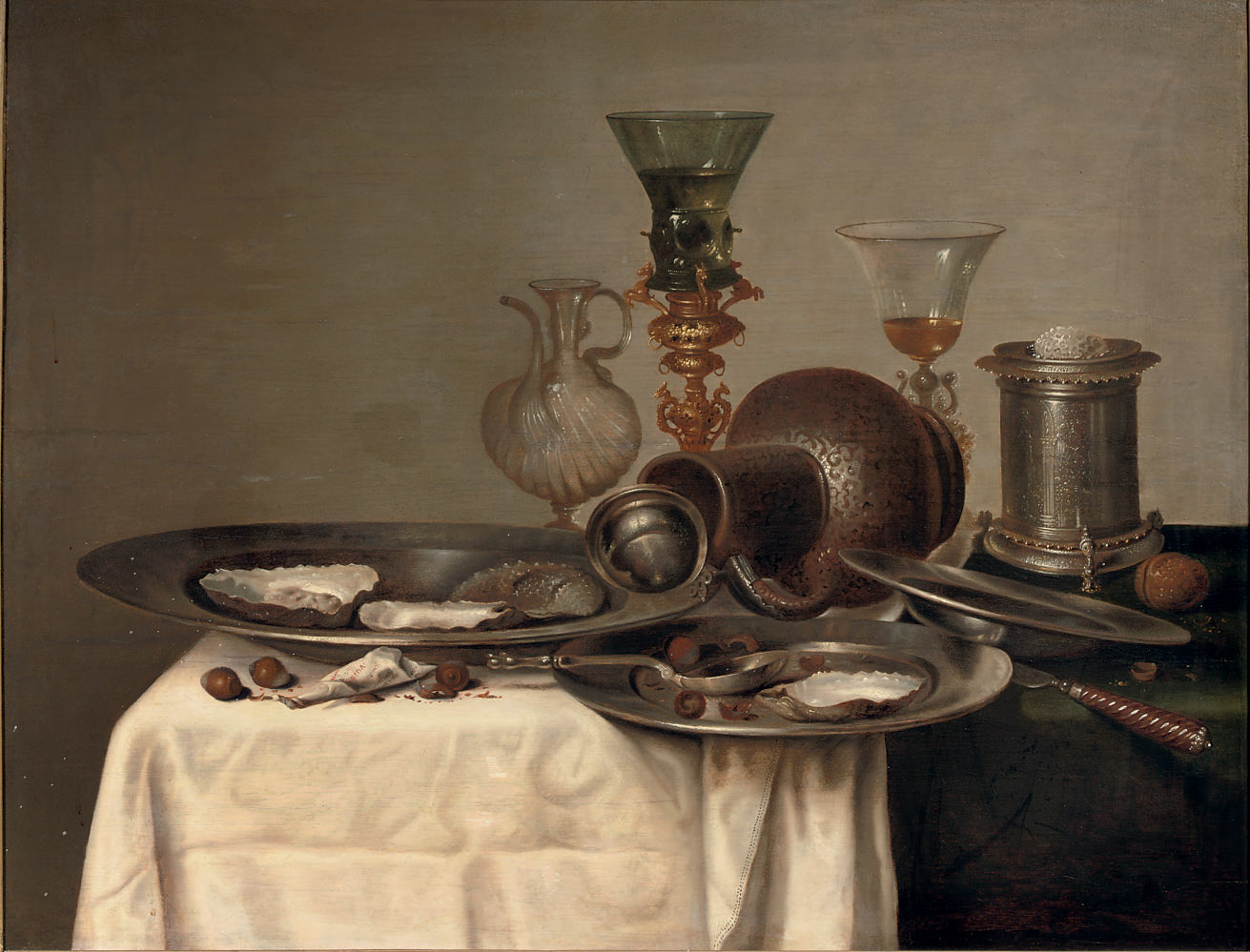 Oysters and hazelnuts on pewter dishes, a 'Roemer' in a 'Bekerschroef', a silver salt cellar and an earthenware jug, all on a partly draped table