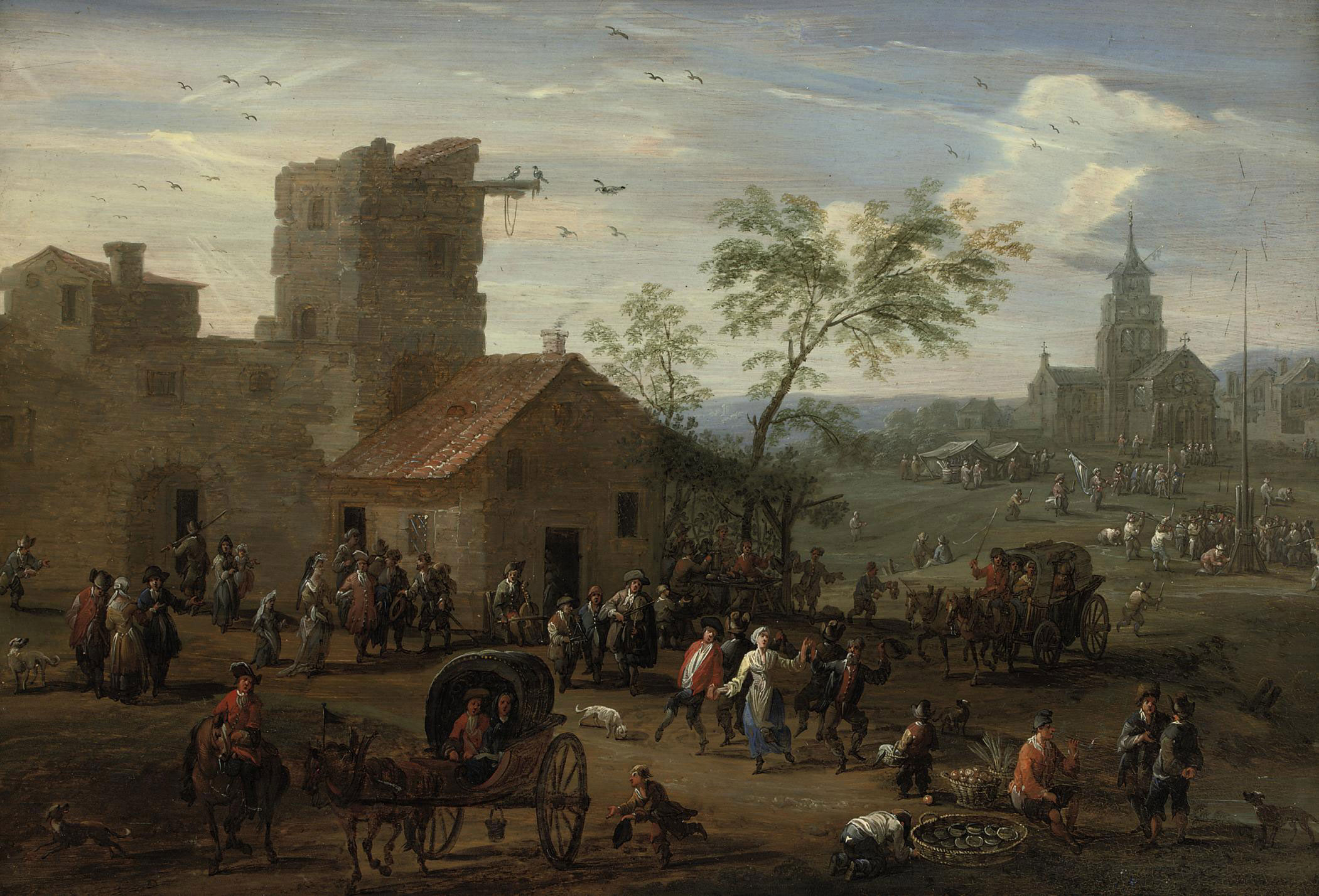 A village 'kermesse' with figures making merry, archers playing a game beyond