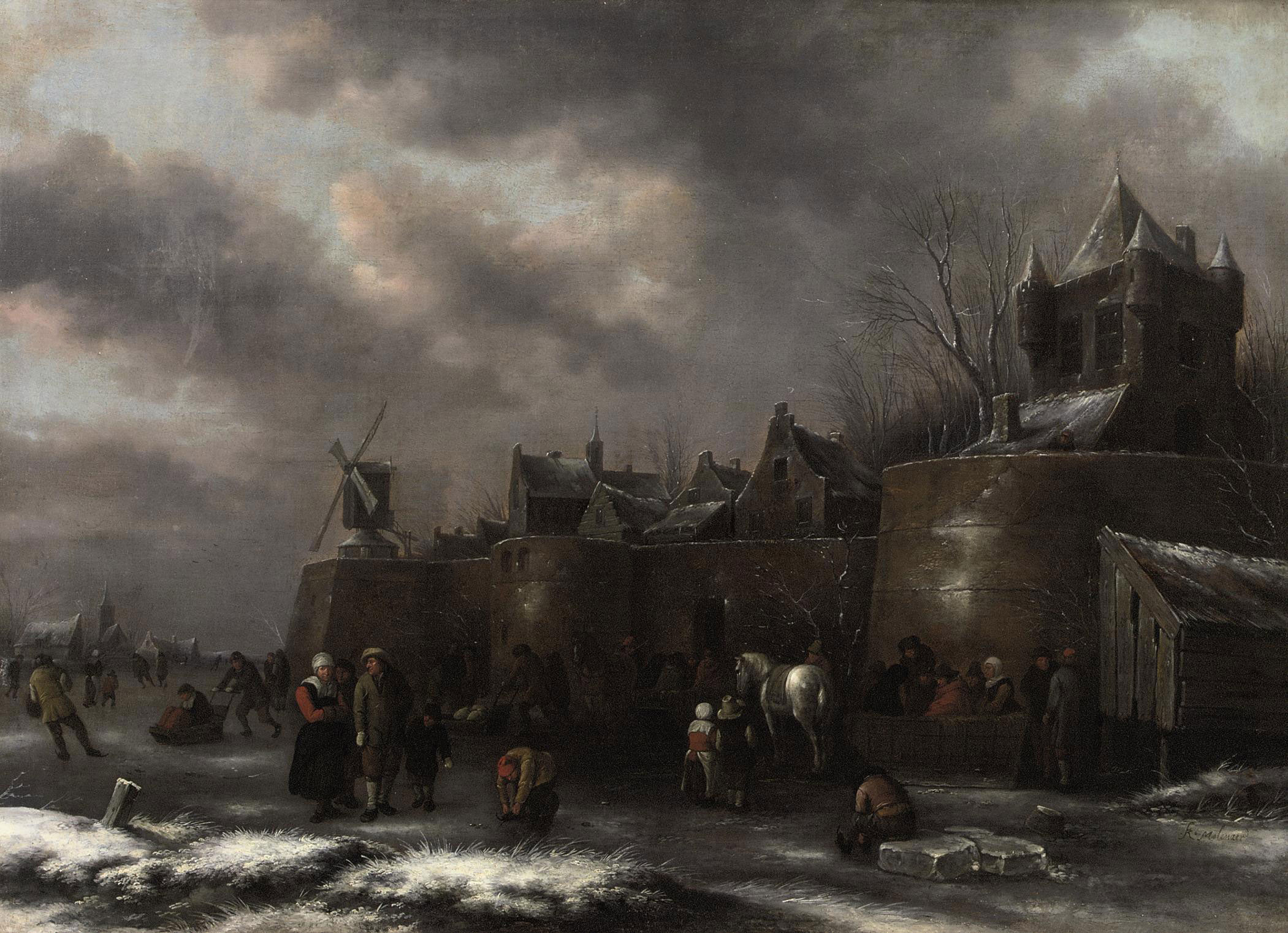 A winter landscape with figures skating and sleighing on a frozen moat outside a fortified town