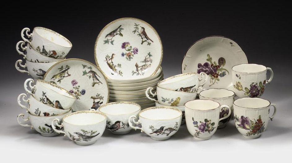Twelve Meissen ornithological cups and eleven saucers and four Ludwigsburg cups and saucers